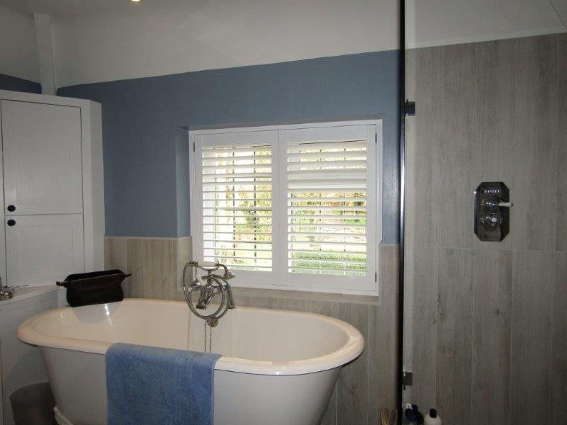 Bathroom shutter by The Window Shutter Company