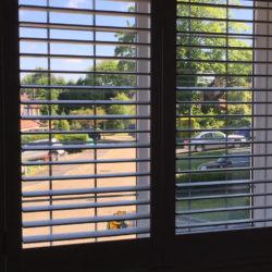 Shutter solutions window blackout blind behind open