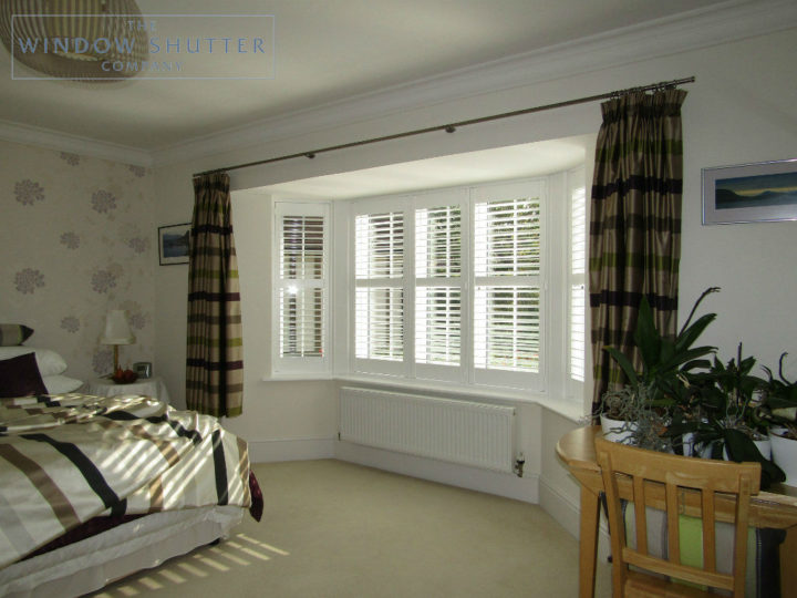 Full height shutter Seattle hidden tilt bay window bedroom Maresfield, East Sussex, with curtains 1