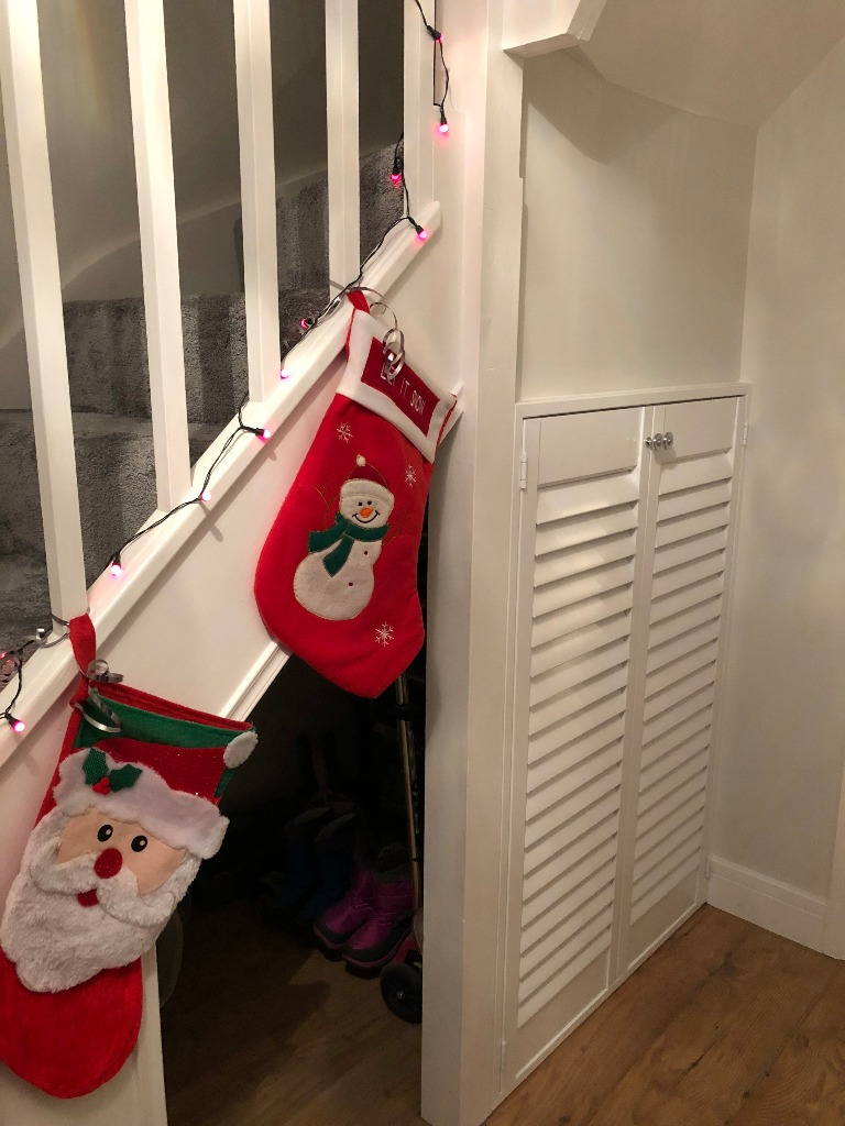 Shutters are not just for windows. Under stairs storage closed with stockings