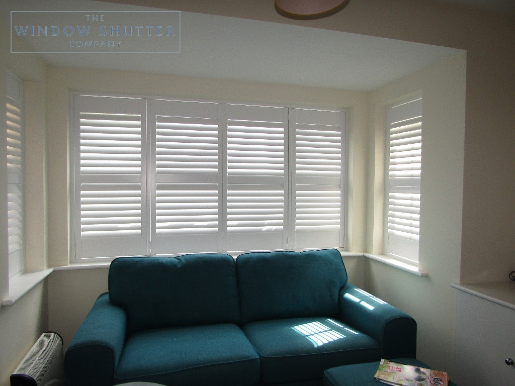 Hidden tilt control mechanism bay window full height shutters, Haywards Heath, louvres half tilt