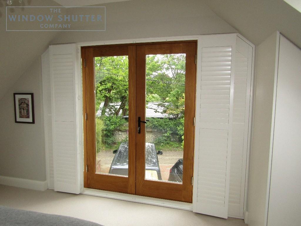 Hidden tilt control mechanism french doors full height shutters, Upper Beeding, shutters half open