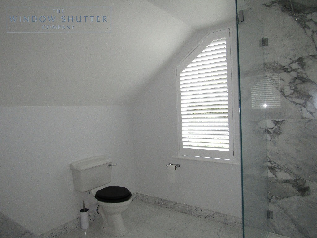 Full height shutters Hollywood, in Pure White, bathroom shaped window, in Esher, Surrey