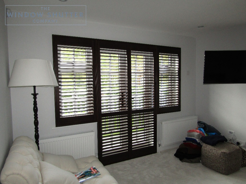 Full height shutters Phoenix hardwood in Wenge, bedroom with balcony, in Esher, Surrey