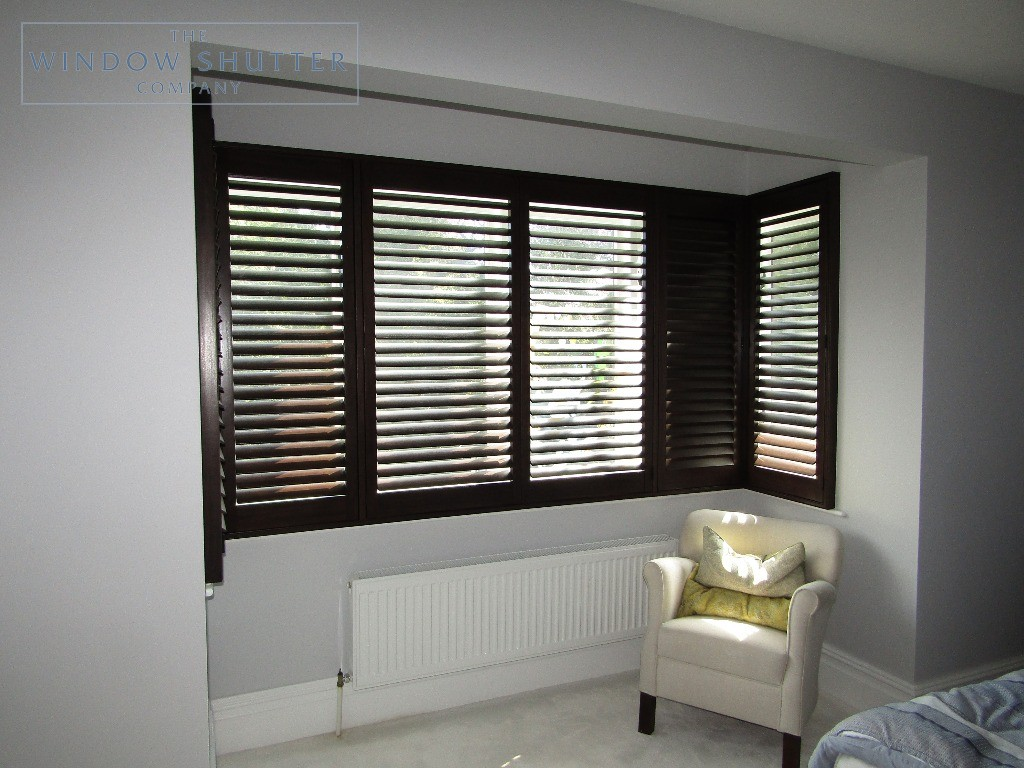 Full height shutters Phoenix hardwood in Wenge, bedroom with box bay window, in Esher, Surrey