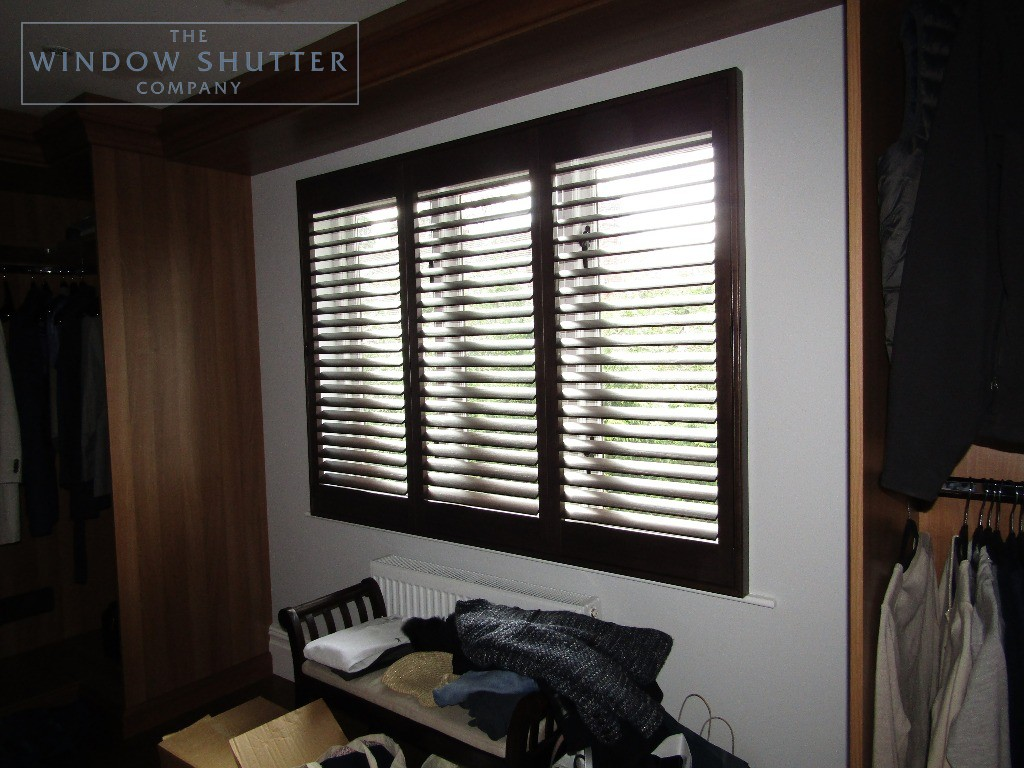 Full height shutters Phoenix hardwood in Wenge, bedroom with dark furniture, in Esher, Surrey
