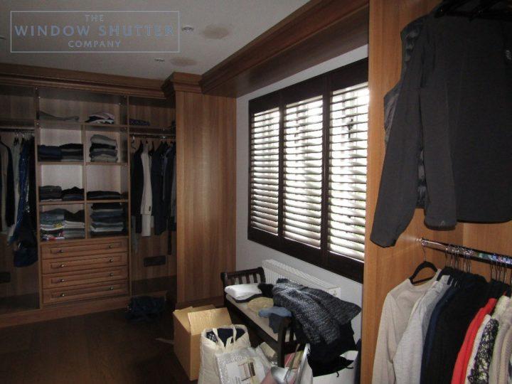 Full height shutters Phoenix hardwood in Wenge, bedroom with dark furniture, in Esher, Surrey