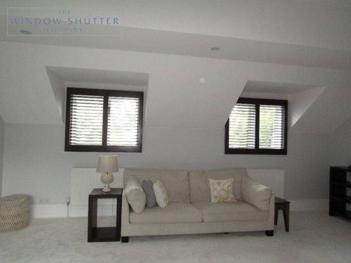 Full height shutters Phoenix hardwood in Wenge, bedroom with twin window shutters open, in Esher, Surrey