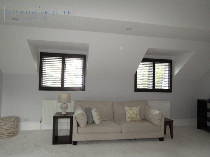 Full height shutters Phoenix hardwood in Wenge, bedroom with twin window shutters open, in Esher, Surrey