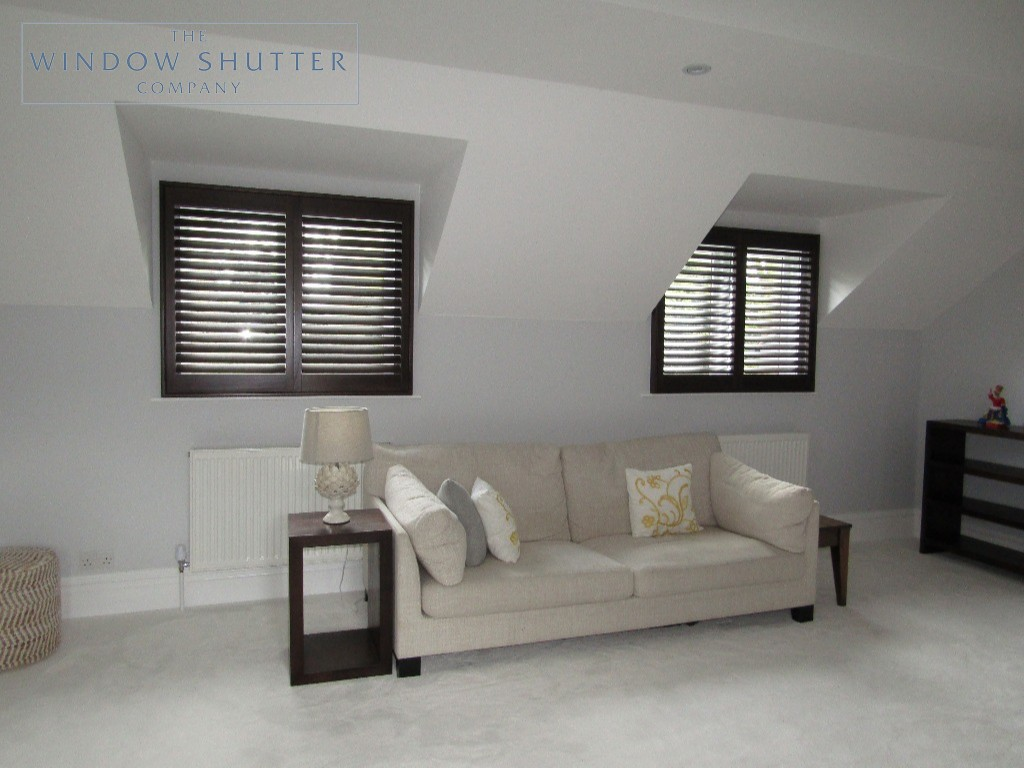 Full height shutters Phoenix hardwood in Wenge, bedroom with twin window shutters tilted, in Esher, Surrey