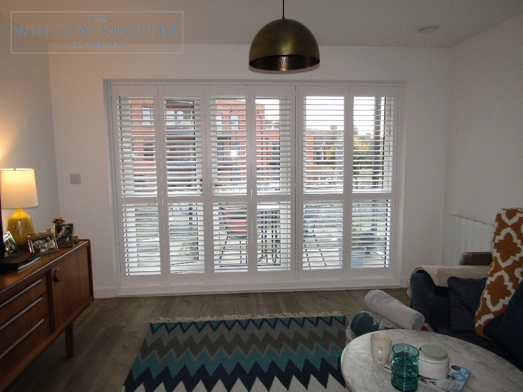 Full height shutters Seattle pure white living room Crawley phase 1