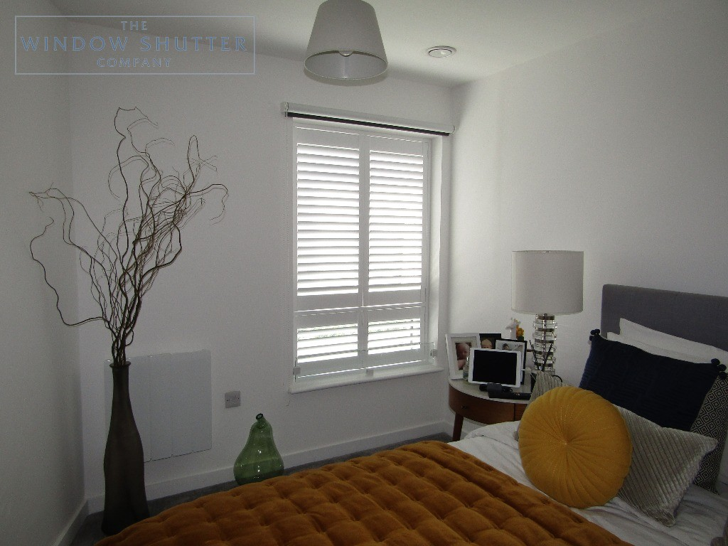 Tier-on-tier blackout shutters Seattle pure white bedroom Crawley 0519, tilted louvres