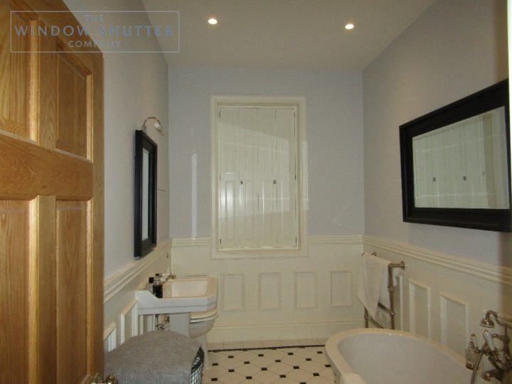 Solid shutters Boston Premium hardwood, Bright White, en-suite bathroom, closed, Haywards Heath