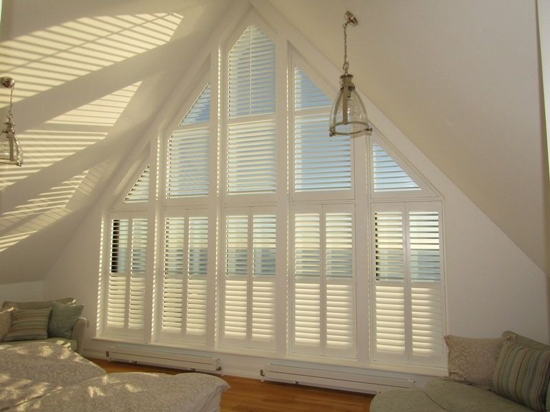 Apex shaped window shutters, louvres open