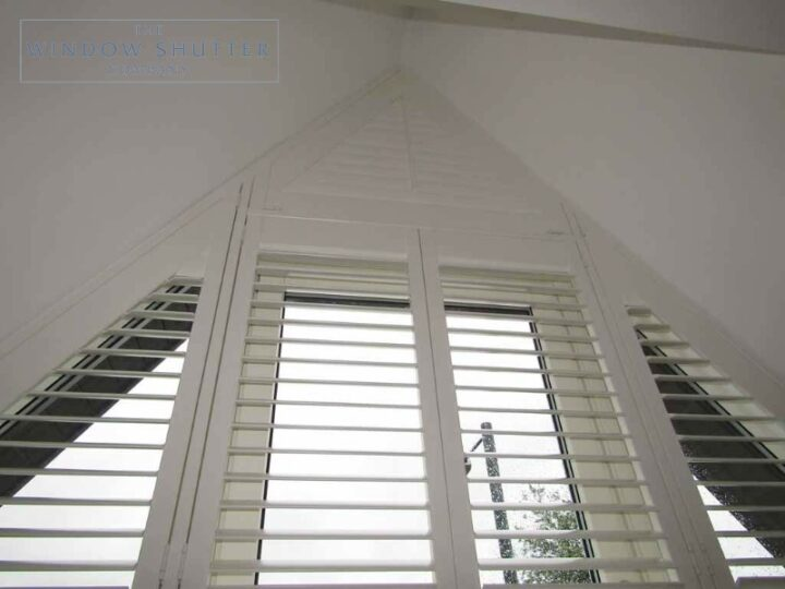 Apex shaped window shutters, louvres open and closed