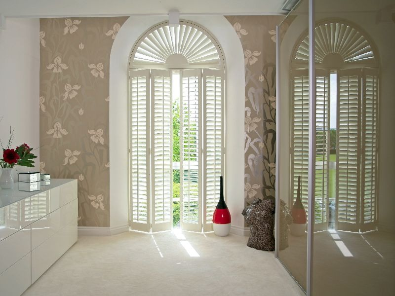 Arched shaped window shutters, sunburst