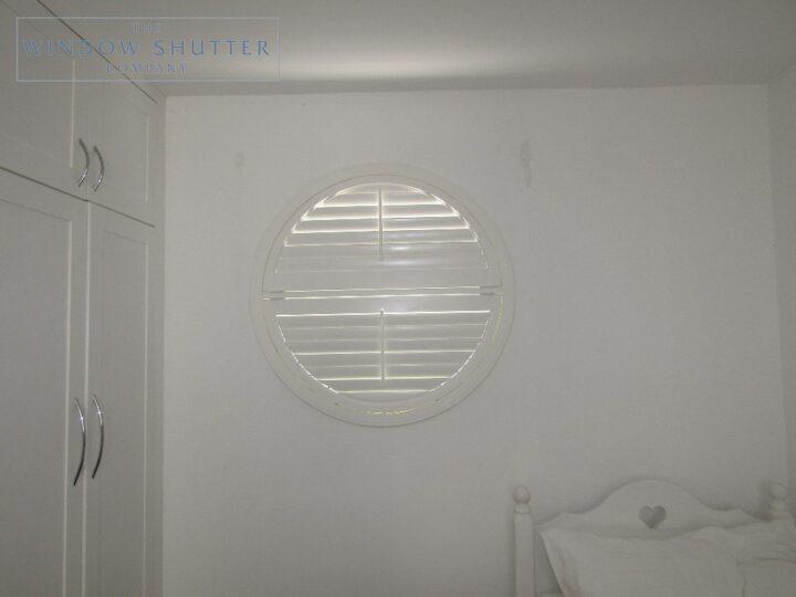 Round porthole shutters, Boston Premium hardwood, bedroom window, Brighton, closed