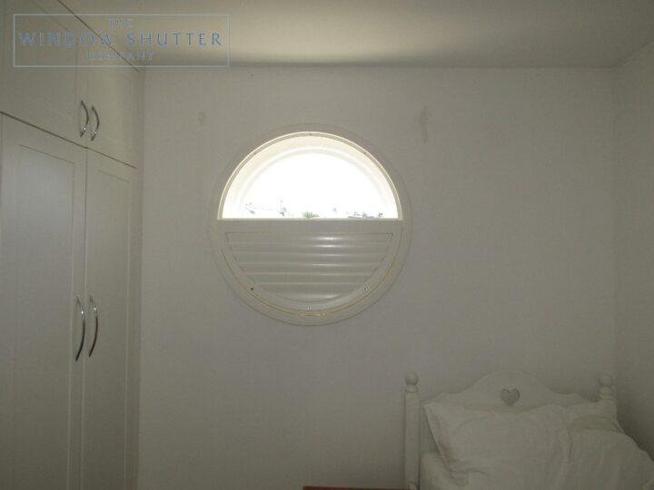 Round porthole shutters, Boston Premium hardwood, bedroom window, Brighton, half open
