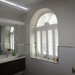 Shaped sunburst shutters, Hollywood waterproof, bathroom window, Reigate, angle