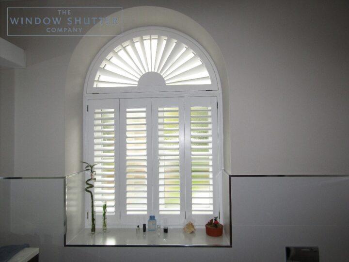 Shaped sunburst shutters, Hollywood waterproof, bathroom window, Reigate, front