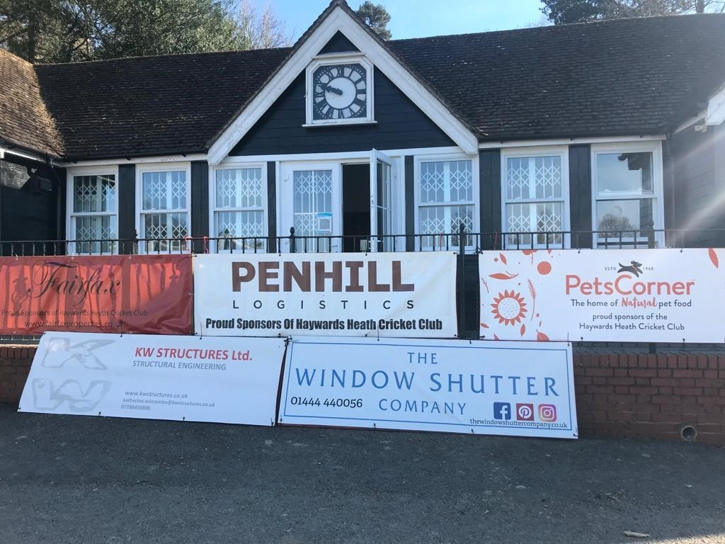 A photo showing our pitchside banner for Haywards Heath cricket club, who were are sponsoring this season