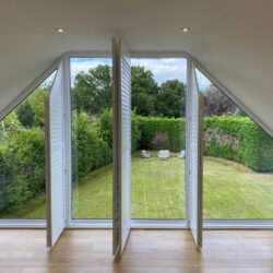 Shaped shutter solution for raked windows in High Wycombe, featured image