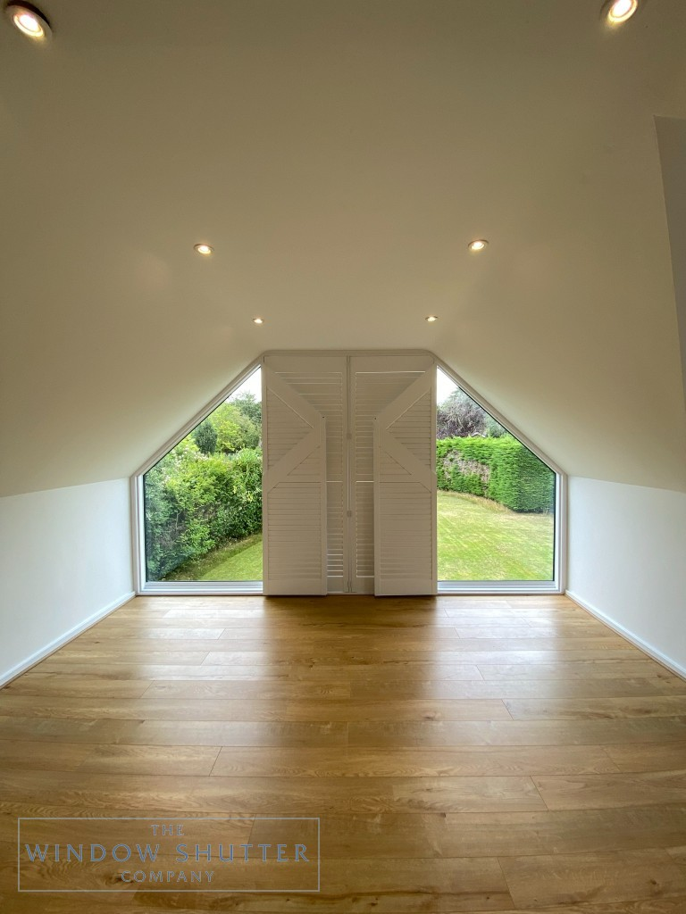 Shaped shutter solution for raked windows in High Wycombe, full room, shutters part open