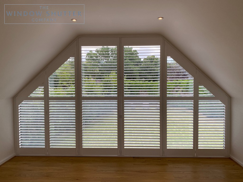 Shaped shutter solution for raked windows in High Wycombe, louvres open
