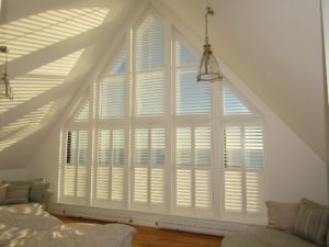 Shaped shutter installation for apex window in Hastings penthouse
