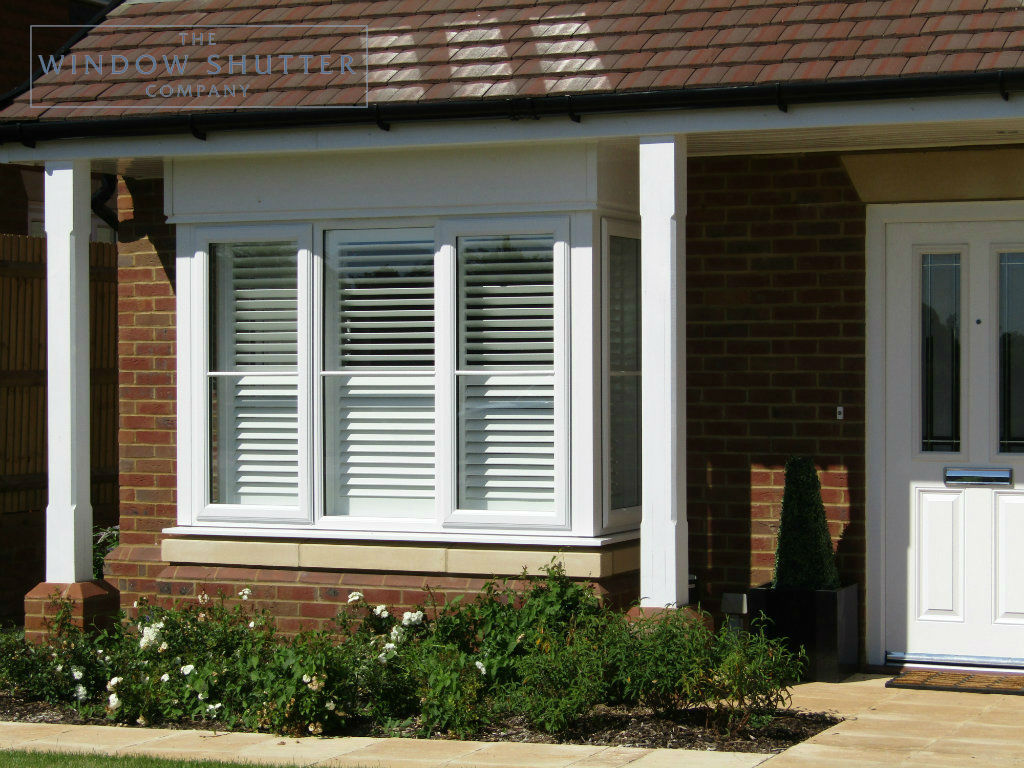 Full height hidden tilt split shutter Boston premium pure white 63mm easy tilt box bay window exterior new build Cuckfield 3 0516