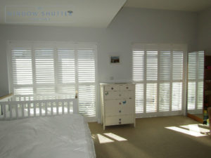 Floor to ceiling full height shutters show off this modern house in Brighton