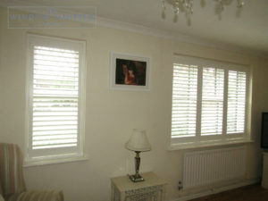 Full height shutters with lead light windows in Burgess Hill, West Sussex