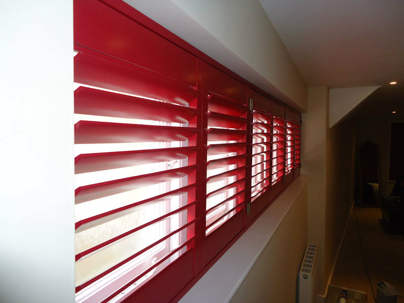 Shutter materials and finishes coloured red