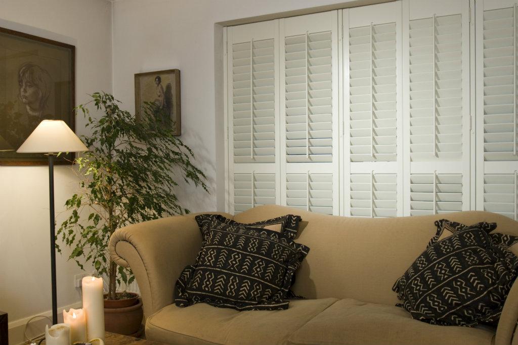 Window, plantation, colonial, indoor, interior, wooden shutters beige sofa