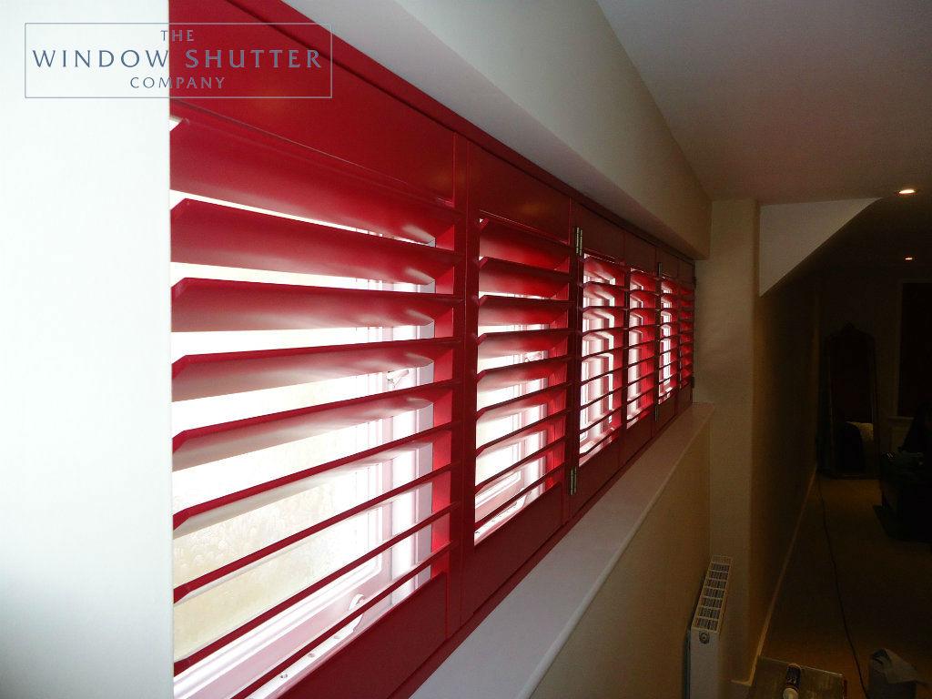 Full height red shutter Carolina easy-tilt master bedroom modern house Reigate Surrey 2 0114
