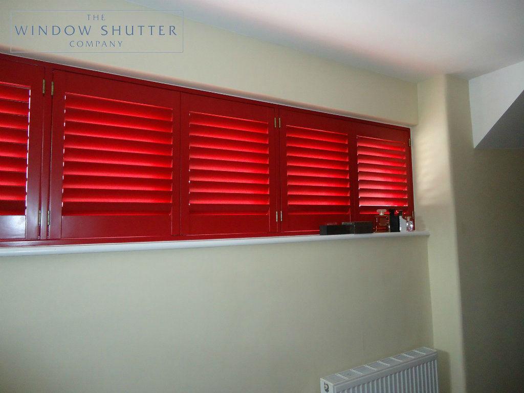 Full height red shutter Carolina easy-tilt master bedroom modern house Reigate Surrey 3 0114