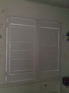 Shutter solutions window blackout blind behind closed