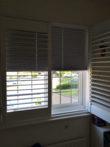 Shutter solutions window blackout blind behind half closed