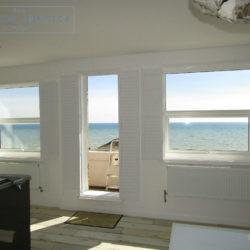 Full height shutter Seattle hidden tilt lounge living room seafront apartment St Leonards-on-Sea, East Sussex folded back 1