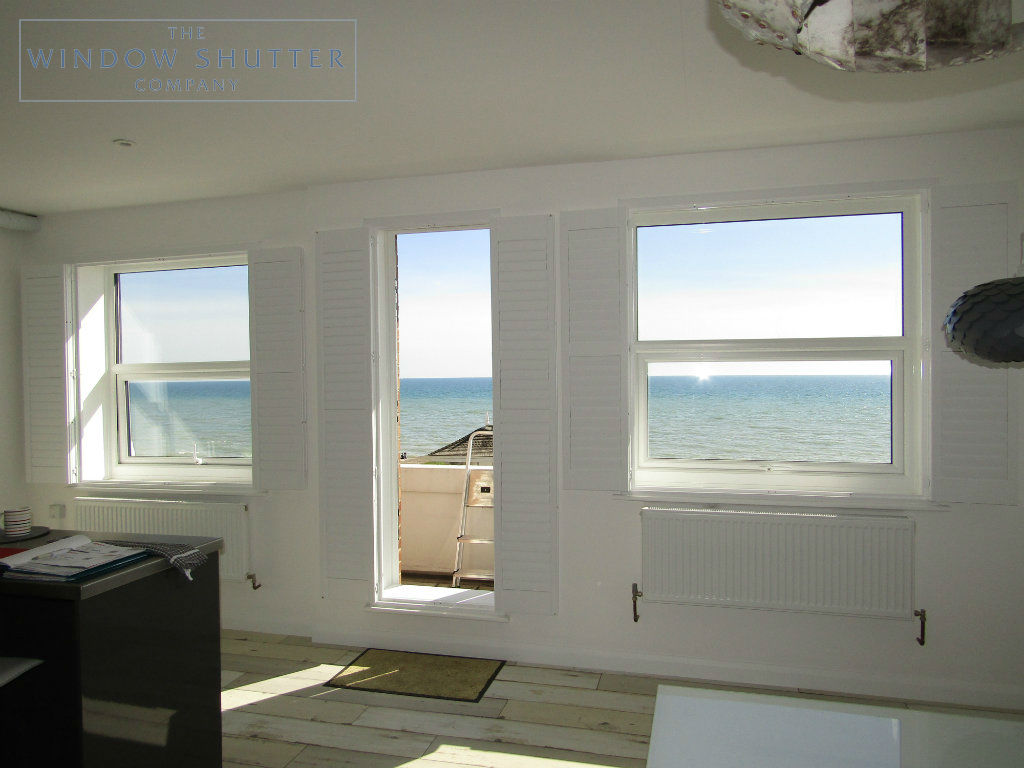 Full height shutter Seattle hidden tilt lounge living room seafront apartment St Leonards-on-Sea, East Sussex folded back 1