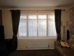 Shutter solutions reducing heat loss louvered shutters with curtain