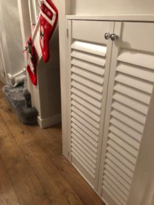 Shutters are not just for windows. Under stairs storage closed showing room for cats